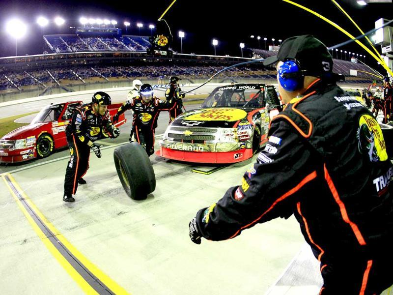 Ty Dillon, driver of the #3 Bass Pro Shops Chevrolet, comes in for a pit stop during the NASCAR Camping World Truck Series Kentucky 201 at Kentucky Speedway in Sparta. AFP/Getty Images/Sean Gardner