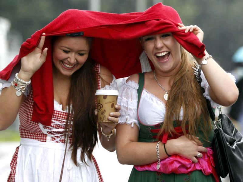 Two women react, as they arrive for the opening of the famous Bavarian
