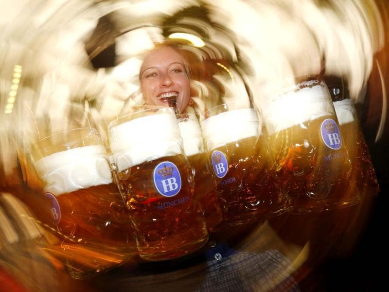 A waitress uses a whistle to free her way while carrying ten of the traditional one-litre 'Masskrug' beer mugs at the opening day of the Munich Oktoberfest at the Theresienwiese in Munich. The world's biggest beer festival runs until October 7. REUTERS/Kai Pfaffenbach