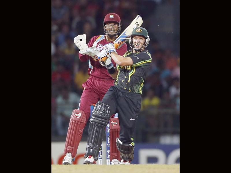 Australia's batsman Michael Hussey, right, plays a shot as West Indies' wicket keeper Denesh Ramdin watches during their ICC Twenty20 Cricket World Cup match in Colombo, Sri Lanka. AP Photo/Eranga Jayawardena