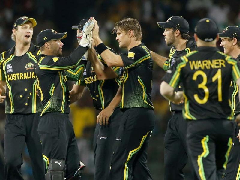 Australia's bowler Shane Watson, center, celebrates the dismissal of West Indies' batsman Chris Gayle, unseen, with team mates during their ICC Twenty20 Cricket World Cup match in Colombo, Sri Lanka . AP Photo/Eranga Jayawardena