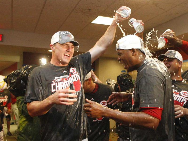Jay Bruce #32 and Aroldis Chapman #54 of the Cincinnati Reds celebrate a National League Central Division Championship during the game against the Los Angeles Dodgers at Great American Ball Park. AFP/Getty Images/John Grieshop