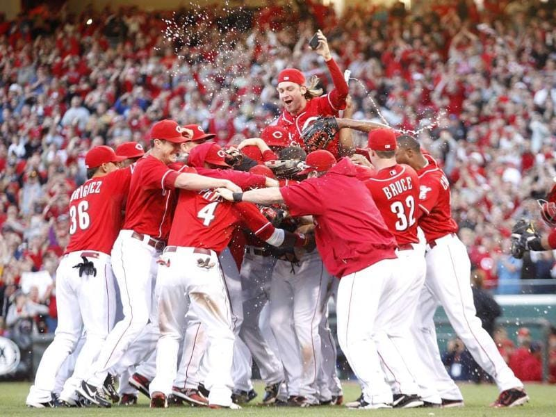Cincinnati Reds players celebrate a National League Central Division Championship during the game against the Los Angeles Dodgers at Great American Ball Park. The Reds defeated the Dodgers 6-0. AFP/Getty Images/John Grieshop