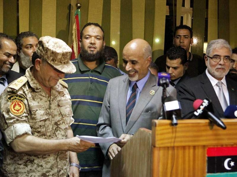 Head of Libya's national congress Mohammed Magarief speaks to Libya's chief of army staff Yusuf al-Mangoush as Libya's Prime Minister Mustafa Abu Shagour stands next to them during a news conference in Benghazi. Reuters/Asmaa Waguih