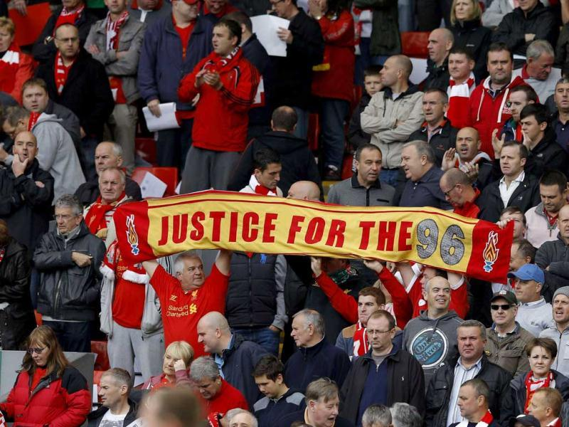 Supporters hold up a scarf in memory of the victims of the Hillsborough disaster before the English Premier League soccer match at Anfield in Liverpool. Reuters Photo
