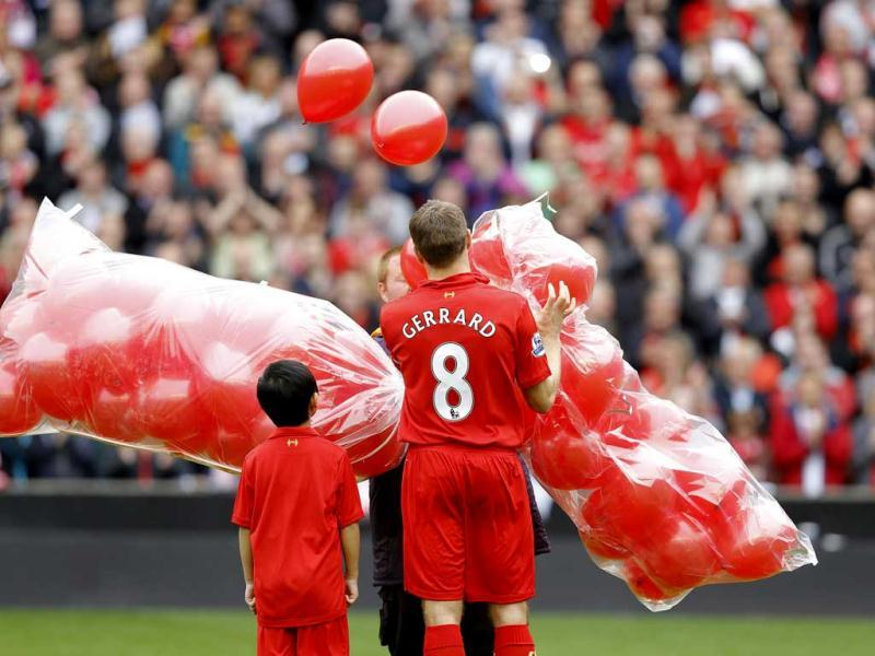 Liverpool's Steven Gerrard releases 96 balloons in memory of the victims of the Hillsborough disaster before the English Premier League soccer match at Anfield in Liverpool. Reuters Photo