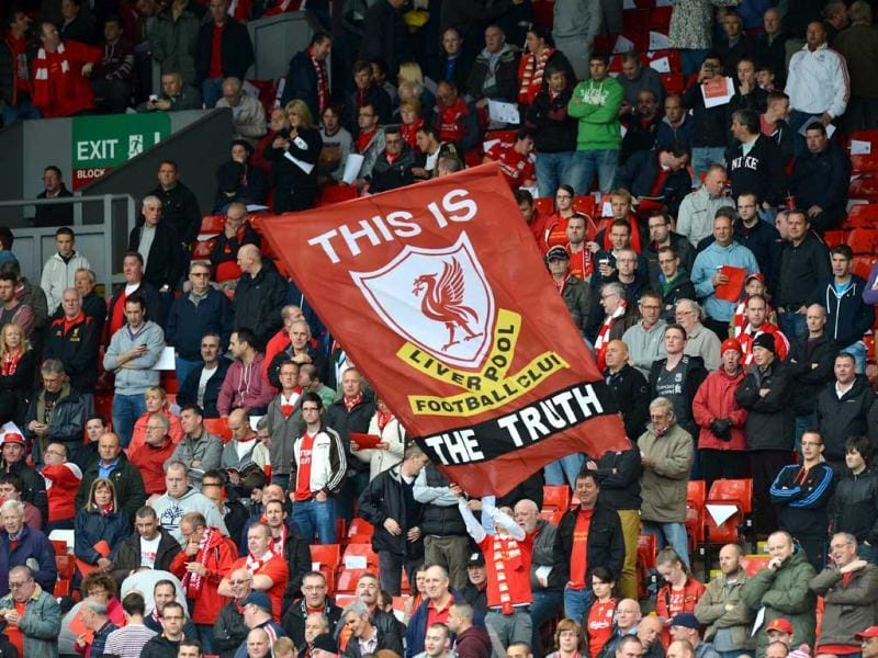 A banner praising the findings of a recent report into the Hillsborough disaster is unfurled in the crowd by Liverpool supporters before the English Premier League football match at Anfield in Liverpool. AFP Photo