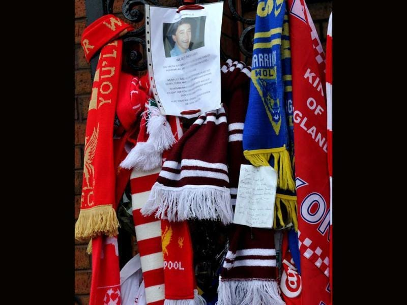 Scarves are placed outside Anfield for the 96 supporters who died in the 1989 Hillsborough disaster before the English Premier League football match at Anfield in Liverpool. AFP Photo