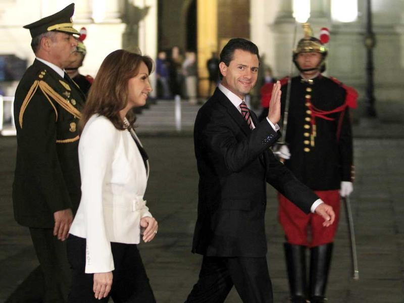 Mexico's President-Elect Enrique Pena Nieto waves next to his wife Angelica Rivera during their arrival to a meeting with President Ollanta Humala at the government palace in Lima. Reuters/Enrique Castro-Mendivil