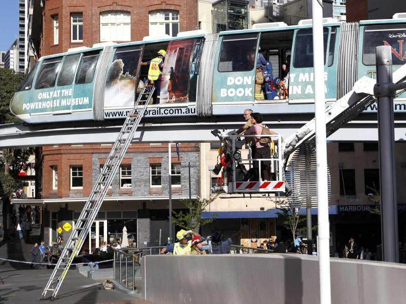 Passengers are rescued from the Monorail after it stopped between stations in central Sydney. Reuters/Daniel Munoz