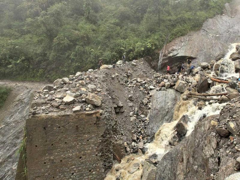 In this handout photograph received from the Sikkim Information and Public Relation Department (IPR) rescue work takes place following landslides caused by flash floods on the Mongon – Chungthang road, some 30 kms north of the Gangtok. (AFP photo)