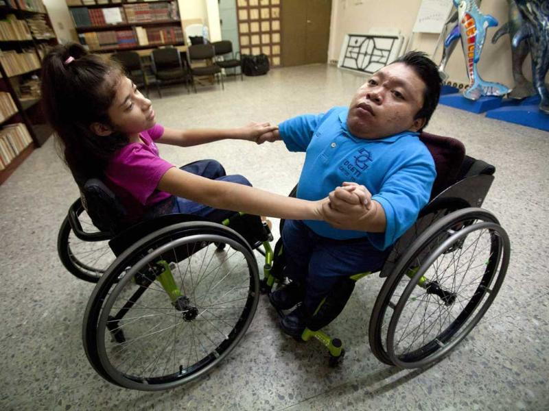 Lucia Tejero and Juan Poot train in a library before the First Regional Dance Competition on Wheelchair Sports in Cancun. Reuters/Victor Ruiz Garcia