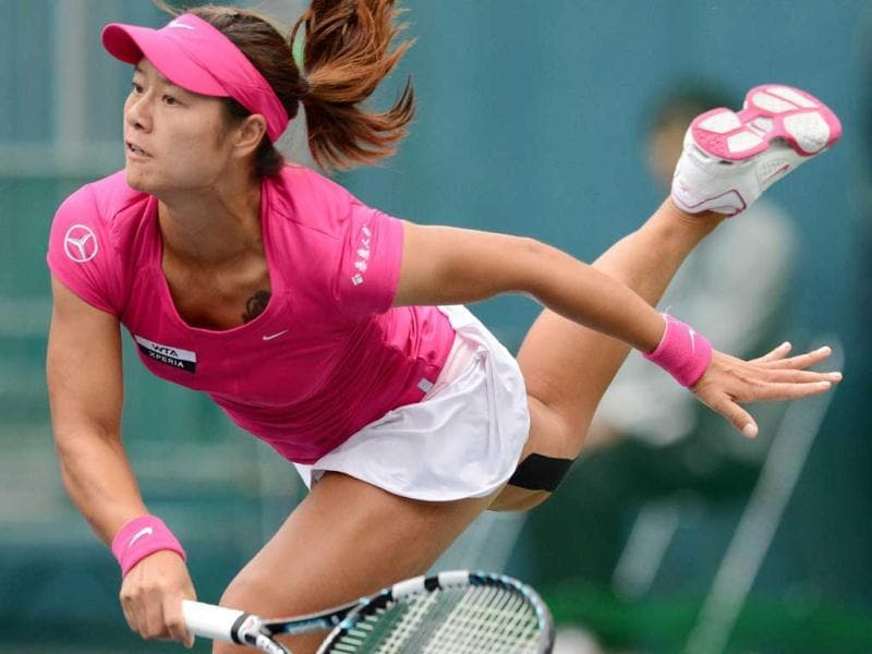 Li Na of China serves against Anastasia Pavlyuchenkova of Russia during their second round match at the Pan Pacific Open tennis tournament in Tokyo. AFP/Toru Yamanaka