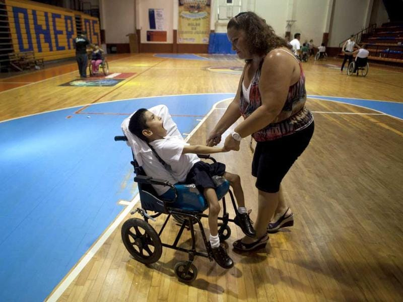 A woman and a child with a disability dance during the First Regional Dance Competition on Wheelchair Sports in Cancun. Reuters/Victor Ruiz Garcia