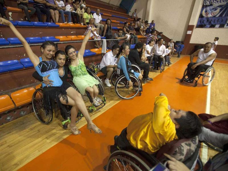 Alondra Lopez, Miguel Osorio and Jazmin Lopez pose for a photo at the end of the First Regional Dance Competition on Wheelchair Sports in Cancun. Reuters/Victor Ruiz Garcia