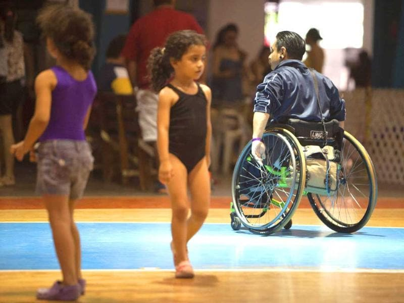 Miguel Osorio (R) trains at a basketball court before the First Regional Dance Competition on Wheelchair Sports in Cancun. Reuters/Victor Ruiz Garcia