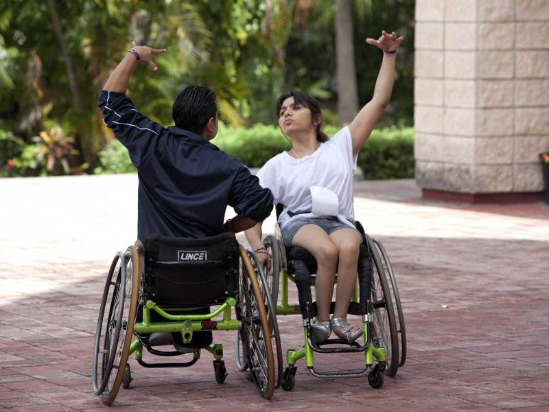 Jazmin Lopez and Miguel Osorio train outside a basketball court before the First Regional Dance Competition on Wheelchair Sports in Cancun. Reuters/Victor Ruiz Garcia