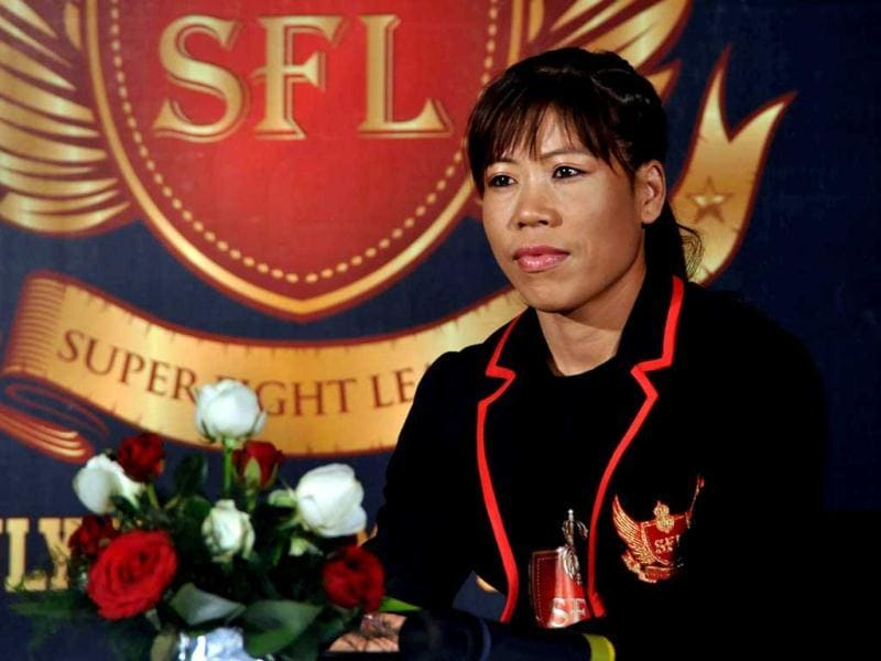 Indian Olympic Female Boxing Bronze Medallist Mary Kom is introduced as the Super Fight League's (SFL) brand ambassador during a press conference in Mumbai on September 24, 2012. (AFP)