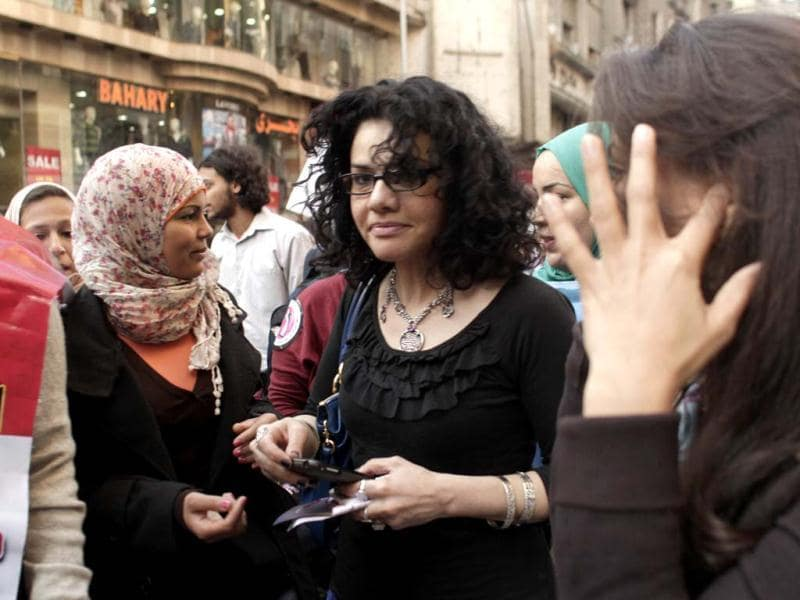 File photo of Egyptian activist Samira Ibrahim, left, and Mona Eltahawy, a prominent Egyptian-born US columnist. Eltahawy has been arrested for spray-painting an advertisement equating Muslim radicals with savages at a New York City subway station. Police say she was arrested Tuesday on charges including criminal mischief and making graffiti. AP Photo