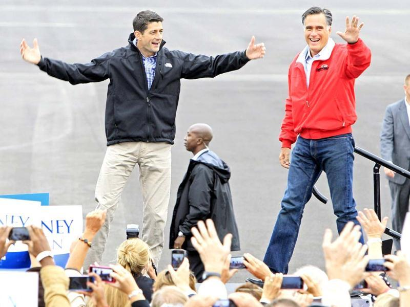Republican US Presidential candidate former Massachusetts Gov. Mitt Romney arrives at a campaign rally with his running mate Republican. Paul Ryan at Wright Brothers Aviation in Vandalia, Ohio. AP Photo