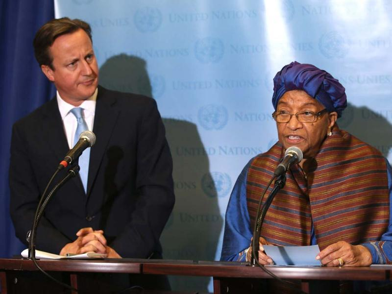 Liberian President Ellen Johnson-Sirleaf speaks while standing with British Prime Minister David Cameron at the United Nations in New York City. The leaders, co-chairs of the Secretary General's High Level Panel on Post 2015, spoke to the media about goals to reduce global poverty. They were at the UN for the 67th annual General Assembly session of more than 100 heads of state and government.  John Moore/Getty Images/AFP