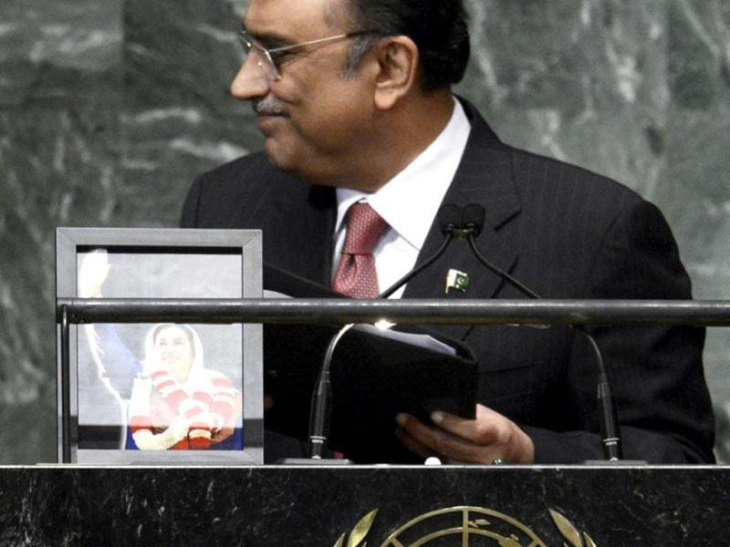 Asif Ali Zardari, President of the Islamic Republic of Pakistan departs after addressing the 67th session of the United Nations General Assembly at the United Nations in New York. A portrait of his late wife, Benazir Bhutto, who was assassinated in 2007, stands on the podium. AFP PHOTO/ TIMOTHY A. CLARY