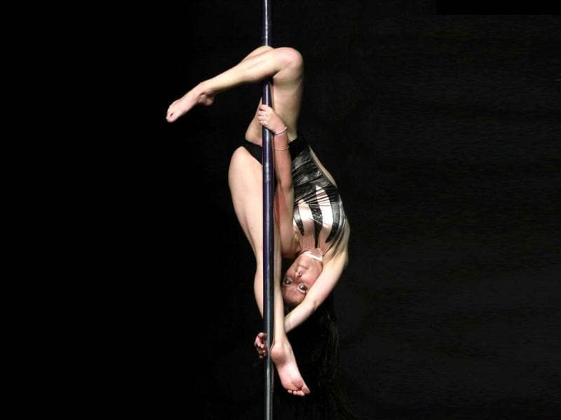Participant Maria Restrepo competes in the annual Colombian pole dancing contest in Medellin. REUTERS/Albeiro Lopera