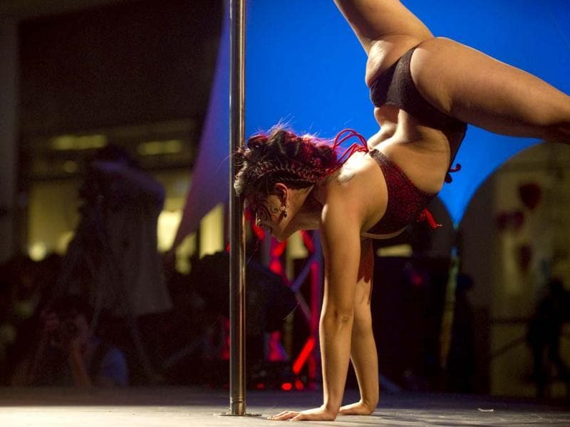 Colombian Kelly Varela competes in the Miss Pole Dance Colombia 2012 competition in Medellin, Antioquia department, Colombia. AFP PHOTO/Raul ARBOLEDA