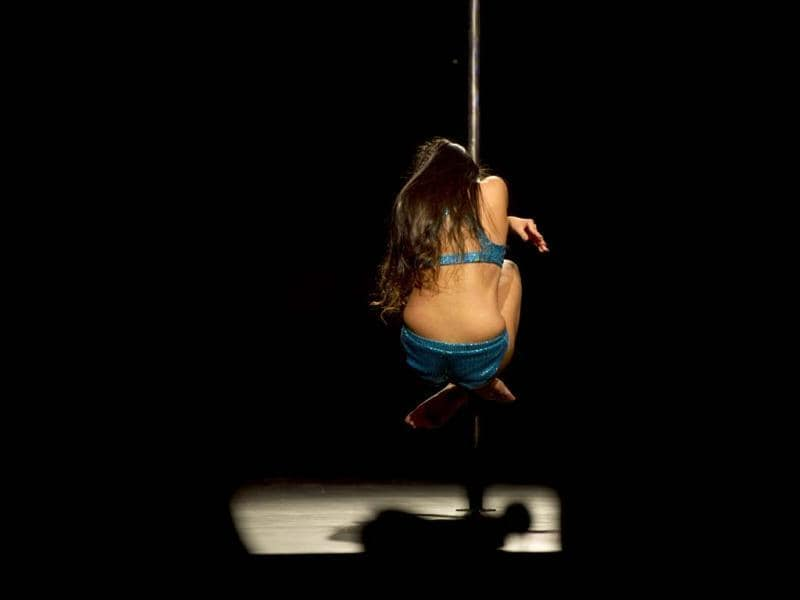 Colombian Maria Prieto competes in the Miss Pole Dance Colombia 2012 competition in Medellin, Antioquia department, Colombia. AFP PHOTO/Raul ARBOLEDA