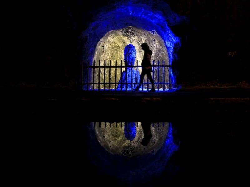 A visitor walks past a statue of the Virgen del Perpetuo Socorro (Our Lady of Perpetual Help), which is reflected in a saltwater pond, in the Nemocon salt mine. The mine is one of Colombia's most popular tourist attractions. Reuters photo