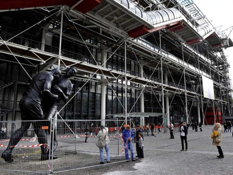 Bronze sculpture by Algerian artist Adel Abdessemed, displayed in front of the Centre Pompidou contemporary art center, aka Beaubourg in Paris. The sculpture immortalizes the