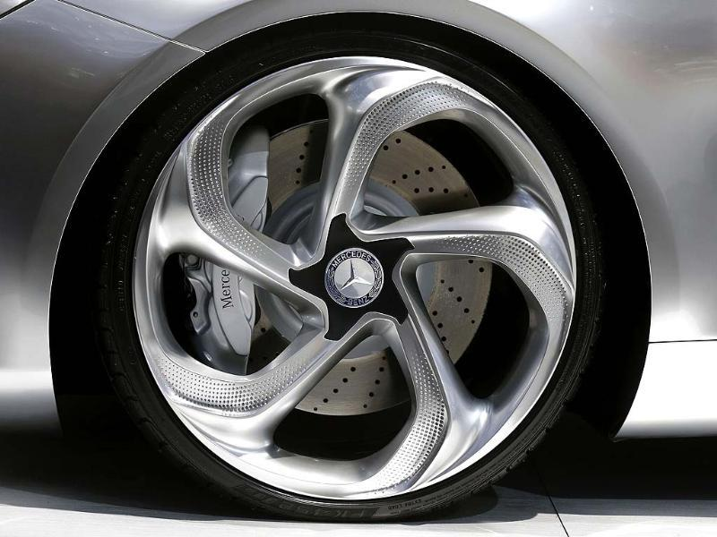 A Mercedes Benz logo is seen on a wheel of a Concept Style Coupe on media day at the Paris Mondial de l'Automobile. Reuters/Jacky Naegelen