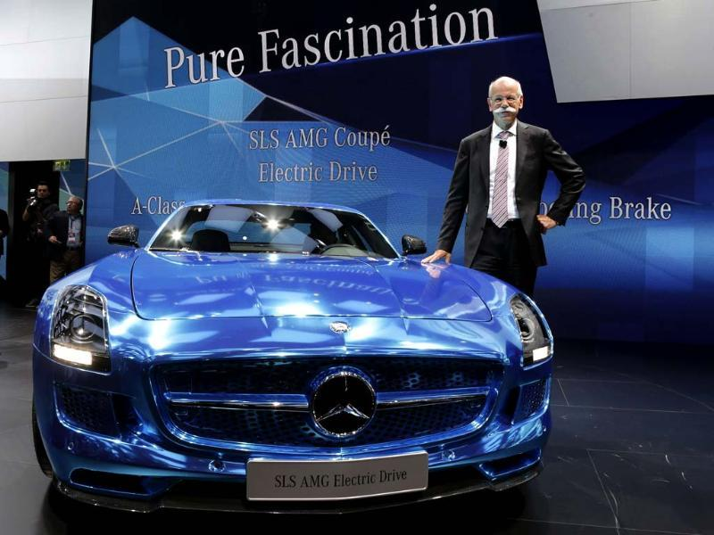 Daimler AG's chief executive officer Dieter Zetsche poses next to a Mercedes Benz SLS AMG Electric Drive model on media day at the Paris Mondial de l'Automobile. Reuters/Jacky Naegelen