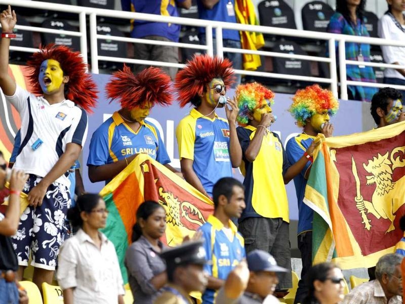 Sri Lankan cricket fans cheer for their team during the ICC Twenty20 Cricket World Cup Super Eight match between New Zealand and Sri Lanka in Pallekele. (AP Photo/Aijaz Rahi)