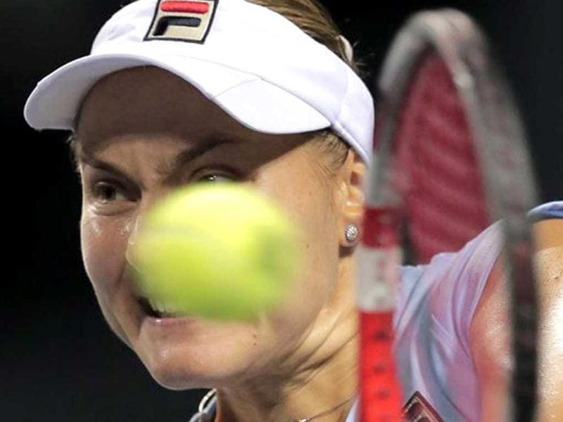 Nadia Petrova of Russia returns a shot to Samantha Stosur of Australia during their semi-final match at the Japan Pan Pacific Open tennis tournament in Tokyo. (AP Photo/Itsuo Inouye)