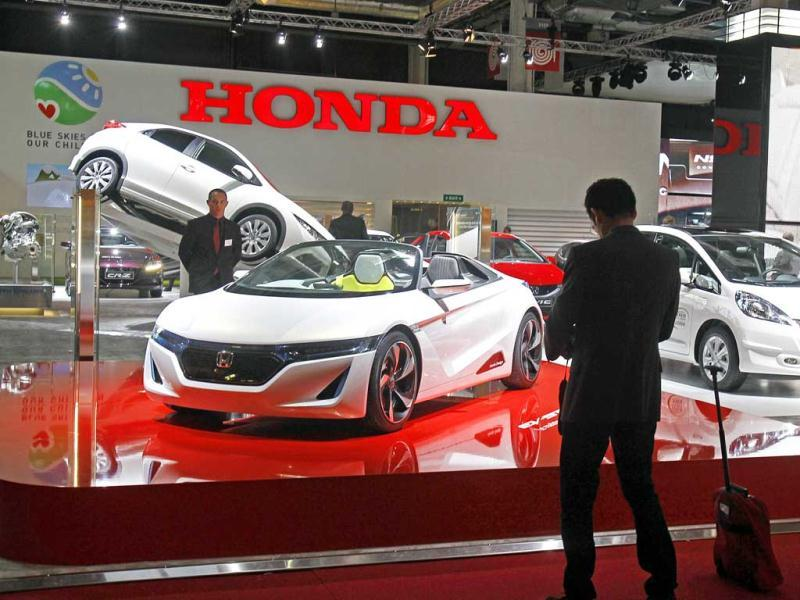 Partial view of the Honda stand on the eve of the opening of the Paris Auto Show, with the EV-Ster roadster visible at foreground and the Jazz hybrid, at right. AP Photo/Remy de la Mauviniere