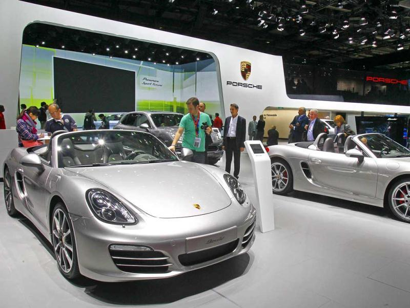 Partial view of the Porsche stand with a the Boxter model, left, on the eve of the opening of the Paris Auto Show. AP Photo/Remy de la Mauviniere