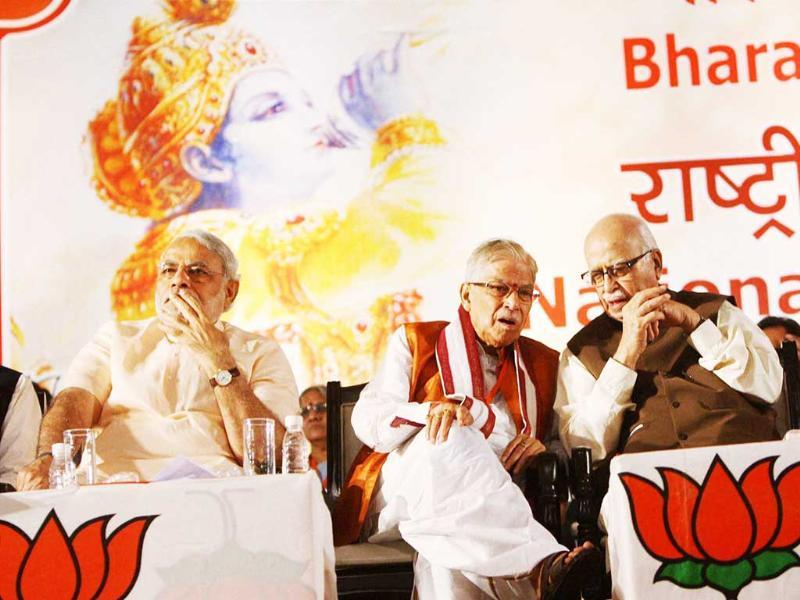 Senior BJP leaders LK Advani, Murli Manohar Joshi and Gujarat chief minister Narendra Modi are seen during the party's National Council Meeting at Surajkund. Subhav Shukla/PTI