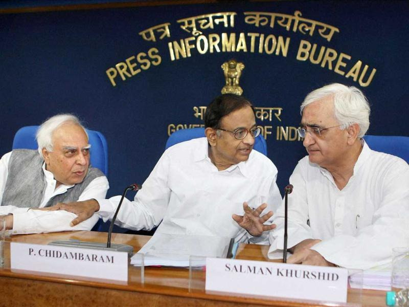 Union Ministers P Chidambaram, Kapil Sibal and Salman Khurshid addressing a press conference in New Delhi. PTI Photo by Vijay Kumar Joshi