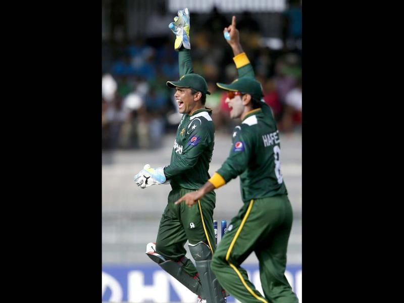 Pakistan's wicket keeper Kamran Akmal and captain Mohammad Hafeez appeal unsuccessfully for a runout decision against South Africa's batsman Farhaan Behardien during their ICC Twenty20 Cricket World Cup Super Eight match in Colombo. AP/Gemunu Amarasinghe