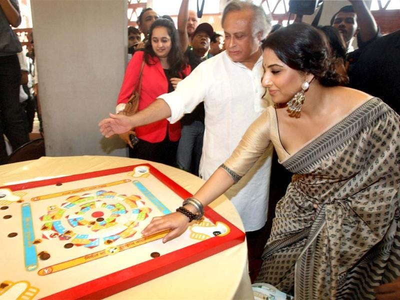 Union rural development minister Jairam Ramesh and actress Vidya Balan looking at a carrom board desined to create awareness, after a press conference for Nirmal Bharat Yatra, an initiative to spread awareness about sanitation, in New Delhi. PTI/Manvender Vashist