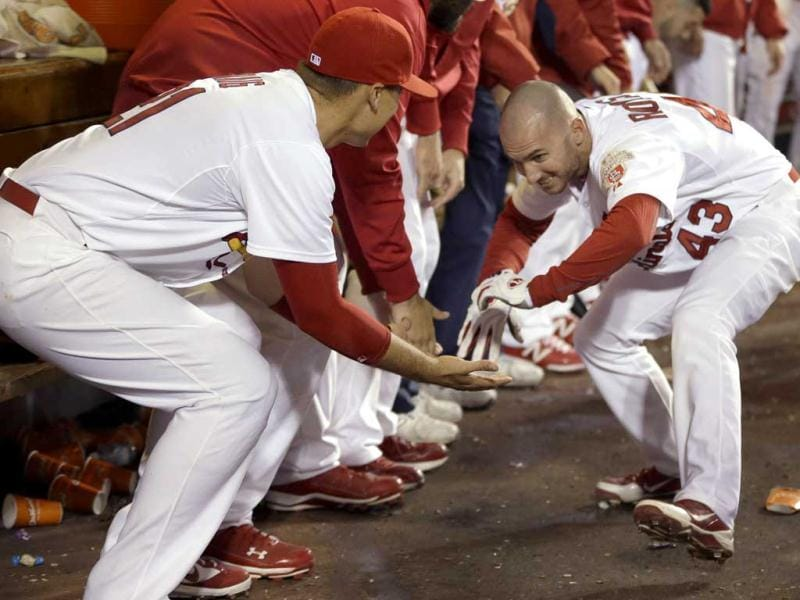St Louis Cardinals' Shane Robinson (R) is congratulated by Allen Craig in the dugout after hitting a two-run home run during the eighth inning of a baseball game against the Washington Nationals in St. Louis. AP Photo