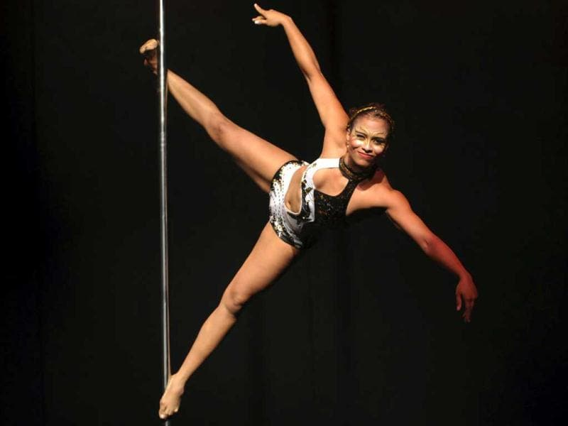A pole dancer performs as she competes in the Miss Pole Dance Colombia 2012 contest in Medellin, Colombia. AP Photo