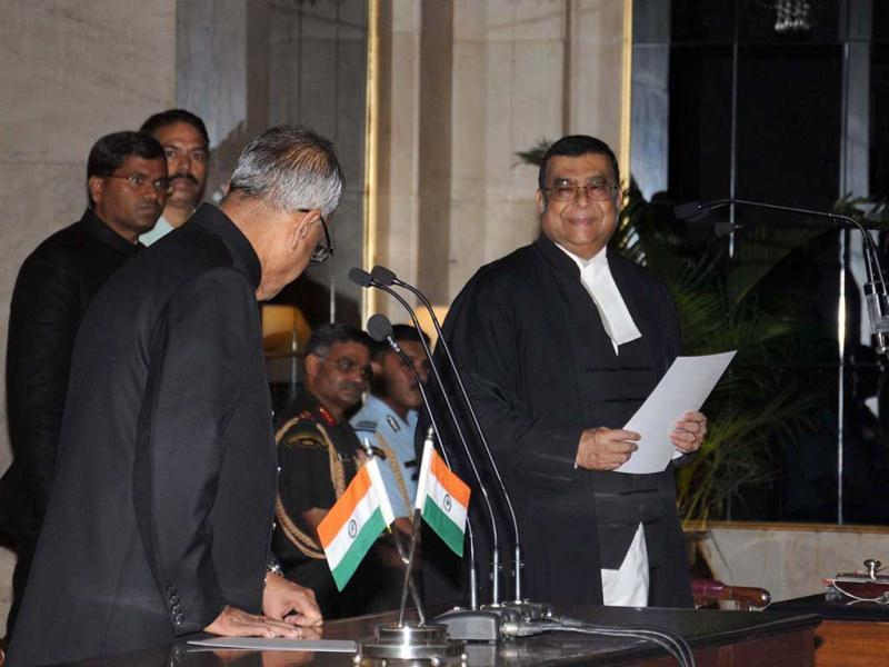 Justice Altamas Kabir thanks President Pranab Mukherjee after swearing in as the new Chief Justice of India at Rashtrapati Bhavan in New Delhi. UNI Photo