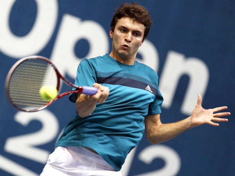 France's Gilles Simon returns the ball to Serbia's Janko Tipsarevic during their men's singles semi-final match at the Thailand Open 2012 tennis tournament in Bangkok. Reuters Photo