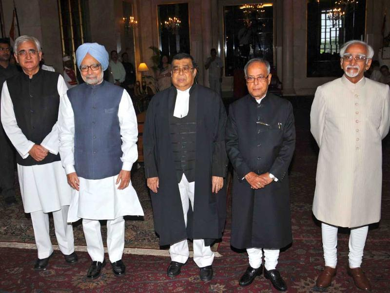 President Pranab Mukherjee, Vice President Hamid Ansari, Prime Minister Manmohan Singh pose for a group photograph with Altamas Kabir the new Chief Justice of India after the swearing-in-ceremony at Rashtrapati Bhavan in New Delhi. UNI