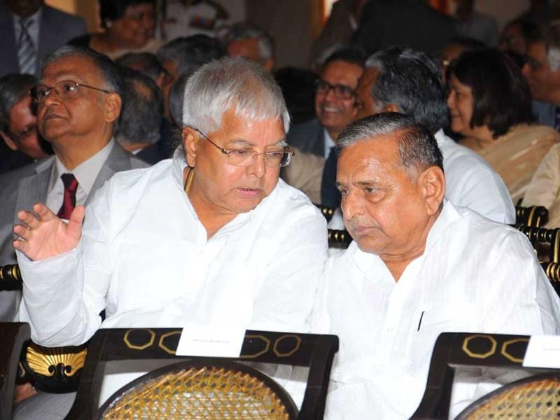 Samajwadi Party supremo Mulayam Singh Yadav and RJD chief Lalu Prasad are seen during the swearing in ceremony of new Chief Justice of India Altamas Kabir at Rashtrapati Bhavan in New Delhi. PTI