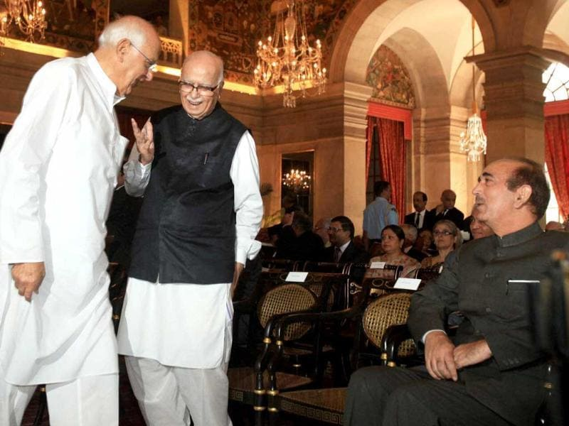 Union new and renewable energy minister Farooq Abdullah talks to senior BJP leader LK Advani as Union health minister Ghulam Nabi Azad looks on during the swearing-in ceremony of the new Chief Justice of India Justice Altamas Kabir at Rashtrapati Bhavan in New Delhi. PTI/Manvender Vashist