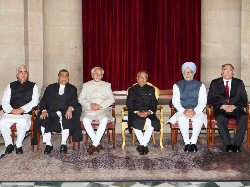 President Pranab Mukherjee, Vice President Hamid Ansari, Prime Minister Manmohan Singh, new Chief Justice of India Justice Altamas Kabir, his predecessor Justice SH Kapadia and Union law minister Salman Khurshid are seen during a group photo session at Rashtrapati Bhavan in New Delhi. PTI