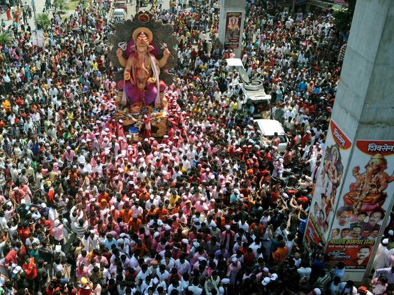 Devotees gather around a huge idol of Lord Ganesha during the procession for immersion into the Arabian Sea, on the streets of Mumbai. AFP photo